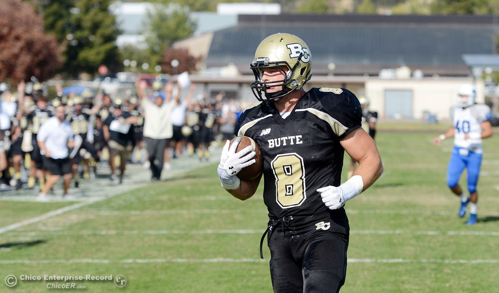 . Butte College\'s #8 Bo Brummel  scores a touchdown against College of San Mateo in the second quarter of their football game at Butte\'s Cowan Stadium Saturday, November 2, 2013 in Oroville, Calif.  (Jason Halley/Chico Enterprise-Record)