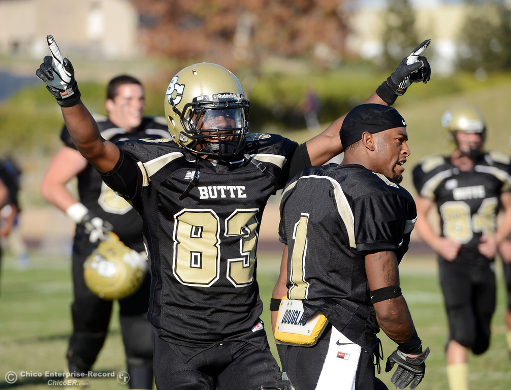 . Butte College\'s #83 Terez Cowan (left) and #1 Wes McCoy celebrate a win against College of San Mateo in the fourth quarter of their football game at Butte\'s Cowan Stadium Saturday, November 2, 2013 in Oroville, Calif.  (Jason Halley/Chico Enterprise-Record)