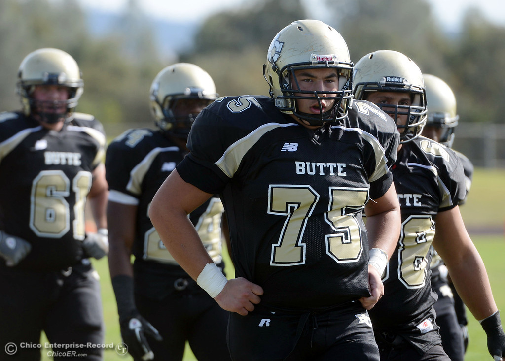 . Butte College\'s #75 Jacob Vazquez (right) looks on against San Mateo College in the first quarter of their football game at Butte\'s Cowan Stadium Saturday, November 2, 2013 in Oroville, Calif.  (Jason Halley/Chico Enterprise-Record)