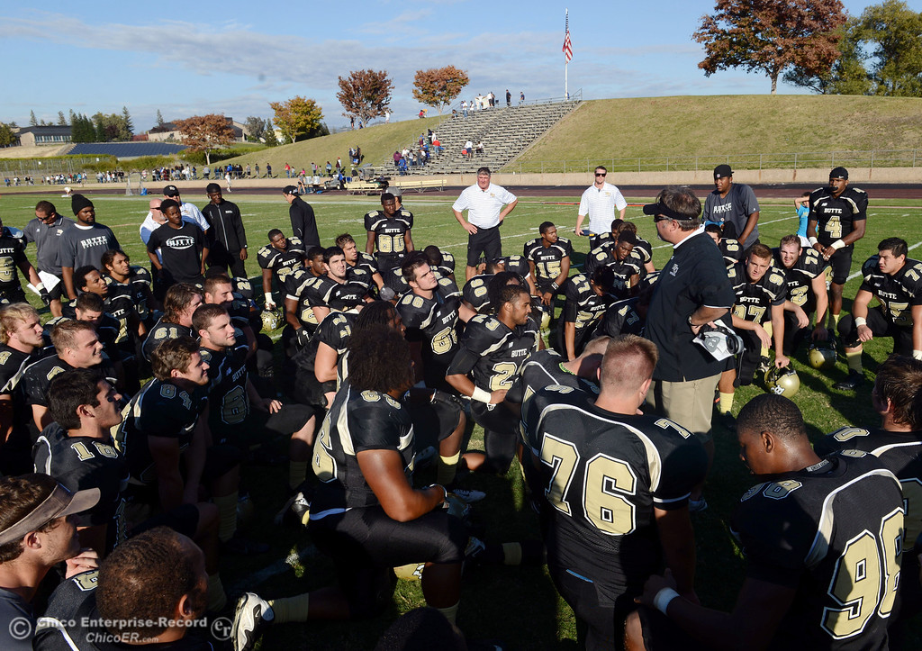 . Butte College coach Jeff Jordan (right) talks to the team on their win against College of San Mateo at the end of the fourth quarter of their football game at Butte\'s Cowan Stadium Saturday, November 2, 2013 in Oroville, Calif.  (Jason Halley/Chico Enterprise-Record)