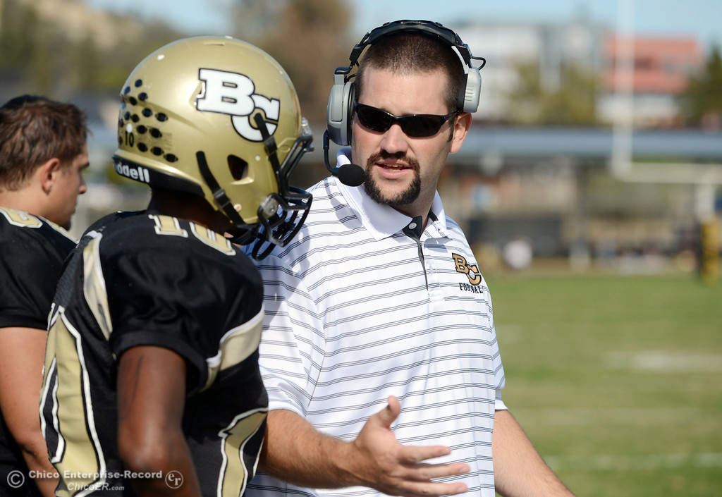 . Butte College coach Rob Snelling (right) talks with #10 CJ Grice (left)against San Mateo College in the first quarter of their football game at Butte\'s Cowan Stadium Saturday, November 2, 2013 in Oroville, Calif.  (Jason Halley/Chico Enterprise-Record)