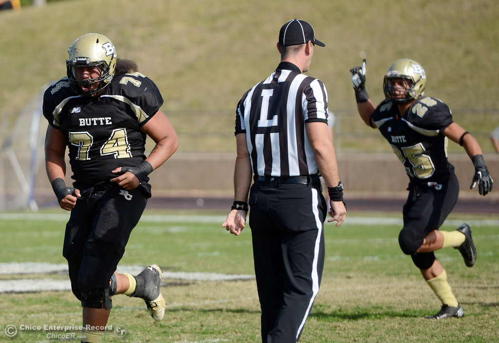 . Butte College\'s #74 Christopher Siliga reacts to a tackle against San Mateo College in the first quarter of their football game at Butte\'s Cowan Stadium Saturday, November 2, 2013 in Oroville, Calif.  (Jason Halley/Chico Enterprise-Record)