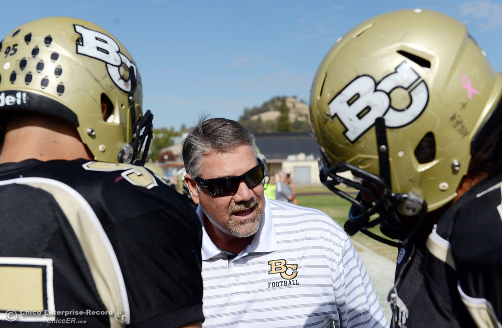 . Butte College coach Willie Thomas talks to the team against San Mateo College in the first quarter of their football game at Butte\'s Cowan Stadium Saturday, November 2, 2013 in Oroville, Calif.  (Jason Halley/Chico Enterprise-Record)