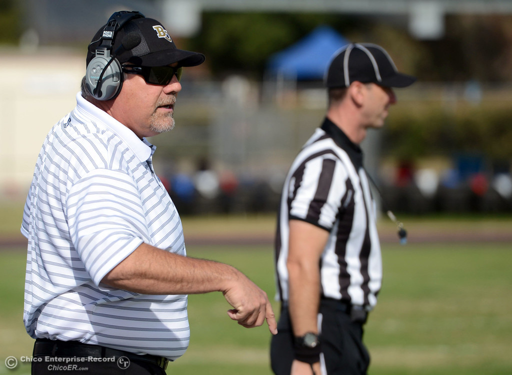 . Butte College coach Willie Thomas looks on against San Mateo College in the first quarter of their football game at Butte\'s Cowan Stadium Saturday, November 2, 2013 in Oroville, Calif.  (Jason Halley/Chico Enterprise-Record)