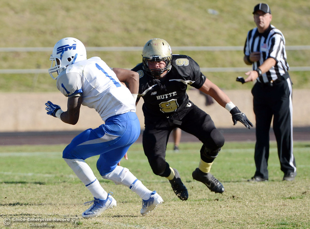 . Butte College\'s #9 Tyler Adair (right) defends against College of San Mateo\'s #1 Quincy Nelson (left) in the third quarter of their football game at Butte\'s Cowan Stadium Saturday, November 2, 2013 in Oroville, Calif.  (Jason Halley/Chico Enterprise-Record)