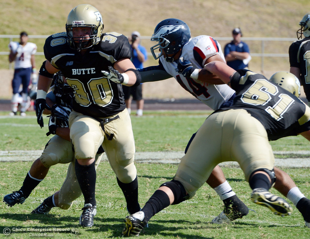 . Butte College\'s #30 Eric DeLucchi blocks against College of the Siskiyous in the third quarter of their football game at Butte\'s Cowan Stadium on Saturday, September 14, 2013, in Oroville, Calif. (Jason Halley/Chico Enterprise-Record)