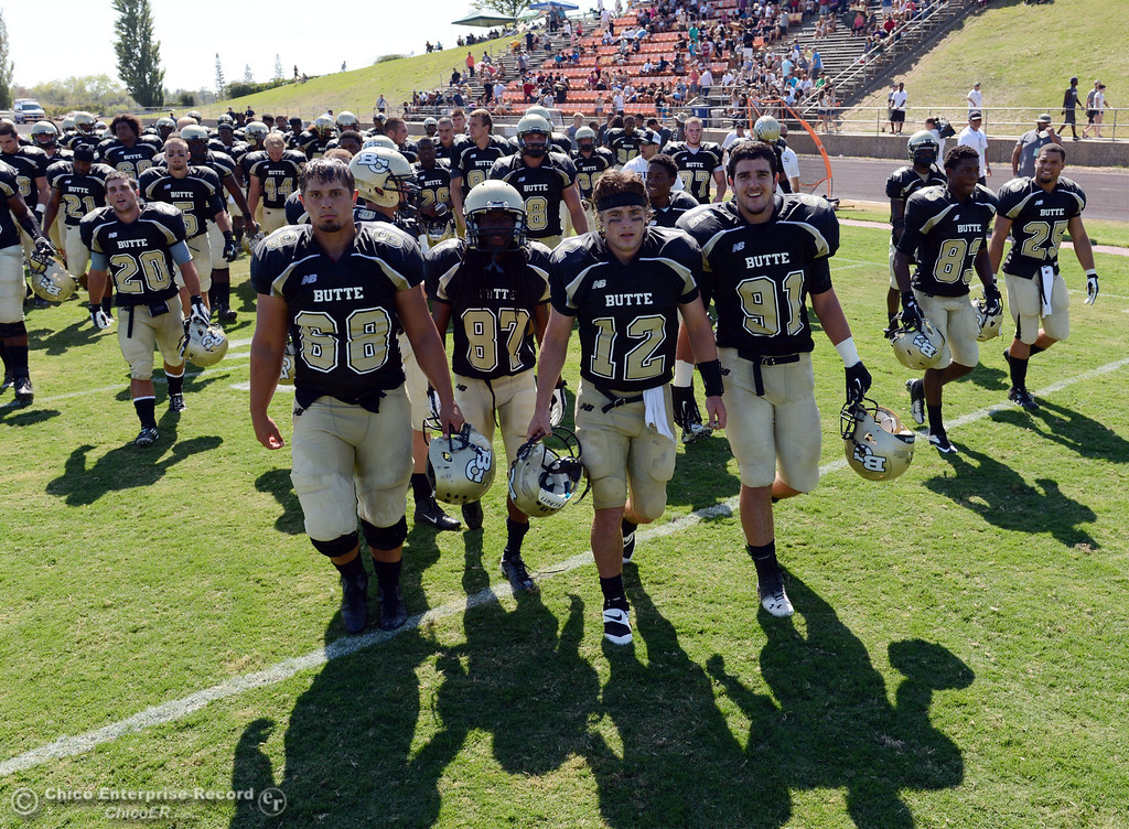 . Butte College\'s #68 Eli Thom, #87 Timazray Shepherd, #12 Thomas Stuart, and #91 Mike Ratianni (left to right) and others walk off the field against College of the Siskiyous at the end of the half of their football game at Butte\'s Cowan Stadium on Saturday, September 14, 2013, in Oroville, Calif. (Jason Halley/Chico Enterprise-Record)