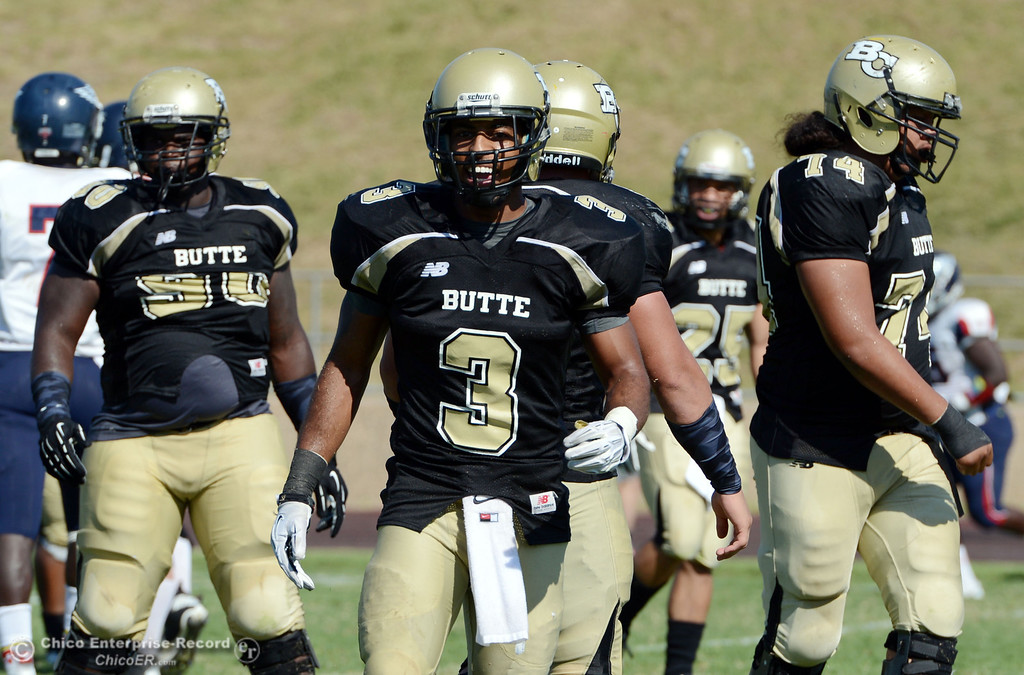 . Butte College\'s #3 London Muse (center) looks on against College of the Siskiyous in the third quarter of their football game at Butte\'s Cowan Stadium on Saturday, September 14, 2013, in Oroville, Calif. (Jason Halley/Chico Enterprise-Record)