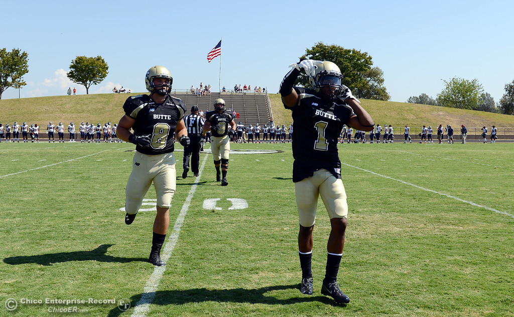 . Butte College\'s #8 Bo Brummell (left) #9 Tyler Adair (back) and #1 Wes McCoy (right) ready against College of the Siskiyous before the first quarter of their football game at Butte\'s Cowan Stadium on Saturday, September 14, 2013, in Oroville, Calif. (Jason Halley/Chico Enterprise-Record)