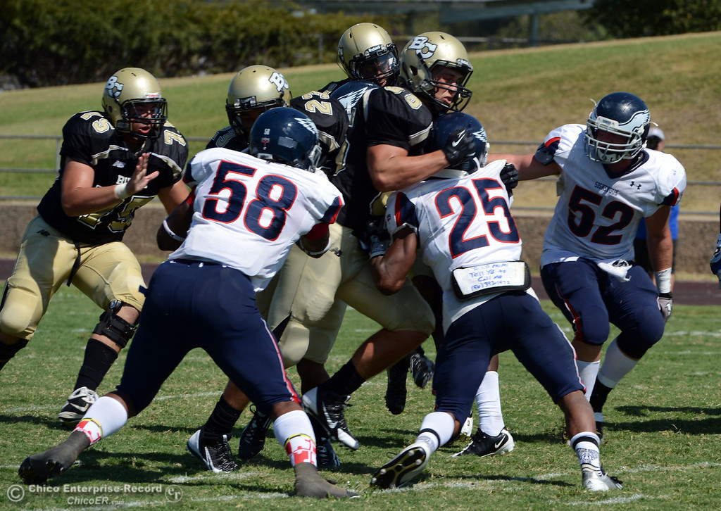 . Butte College against College of the Siskiyous in the first quarter of their football game at Butte\'s Cowan Stadium on Saturday, September 14, 2013, in Oroville, Calif. (Jason Halley/Chico Enterprise-Record)