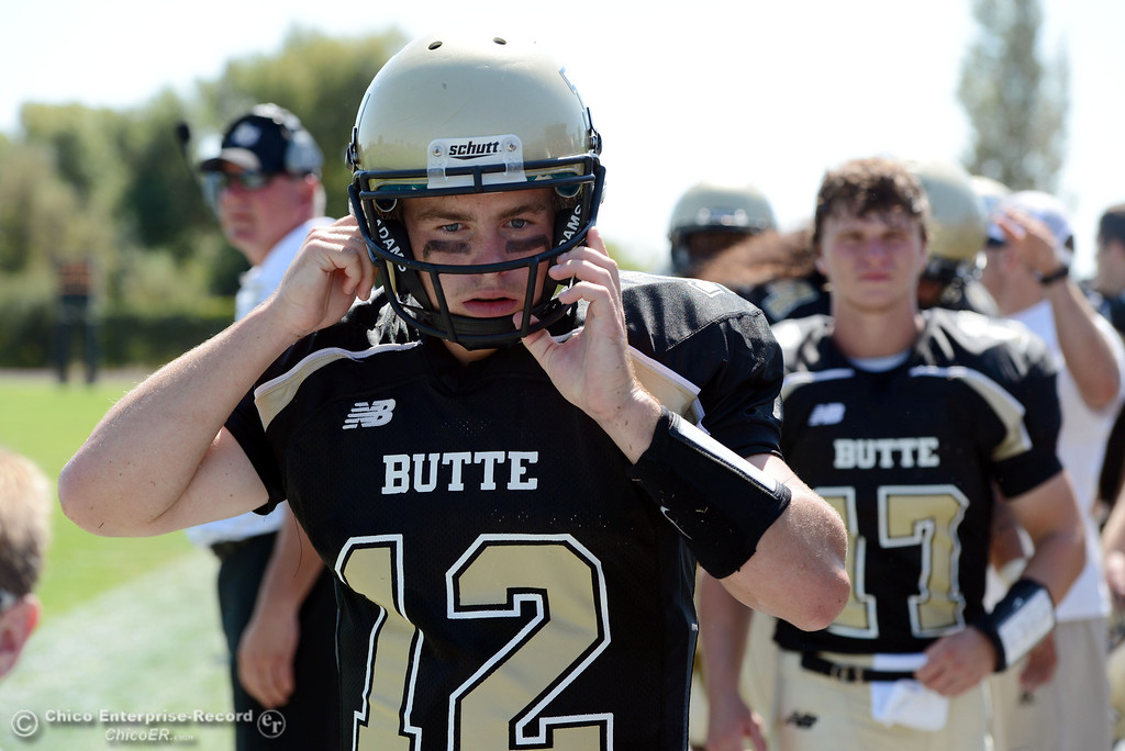 . Butte College\'s #12 Thomas Stuart looks on against College of the Siskiyous in the first quarter of their football game at Butte\'s Cowan Stadium on Saturday, September 14, 2013, in Oroville, Calif. (Jason Halley/Chico Enterprise-Record)