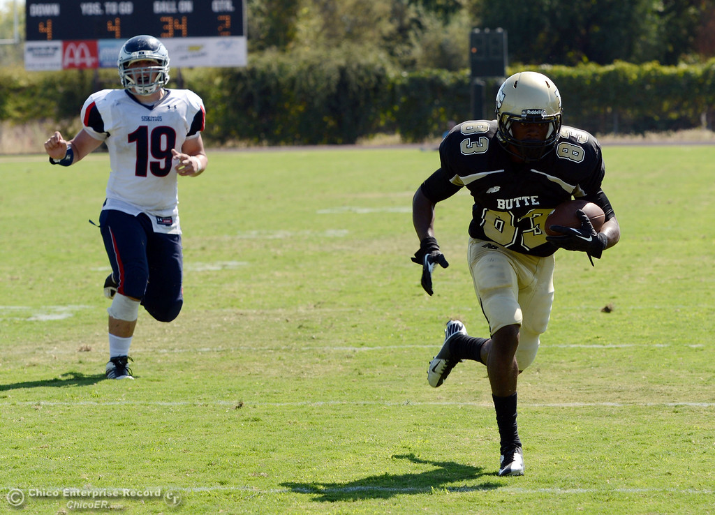 . Butte College\'s #83 Terez Cowan (right) runs in into the end zone against College of the Siskiyous\' #19 Alex Henderson (left) in the second quarter of their football game at Butte\'s Cowan Stadium on Saturday, September 14, 2013, in Oroville, Calif. The touchdown was nullified.  (Jason Halley/Chico Enterprise-Record)