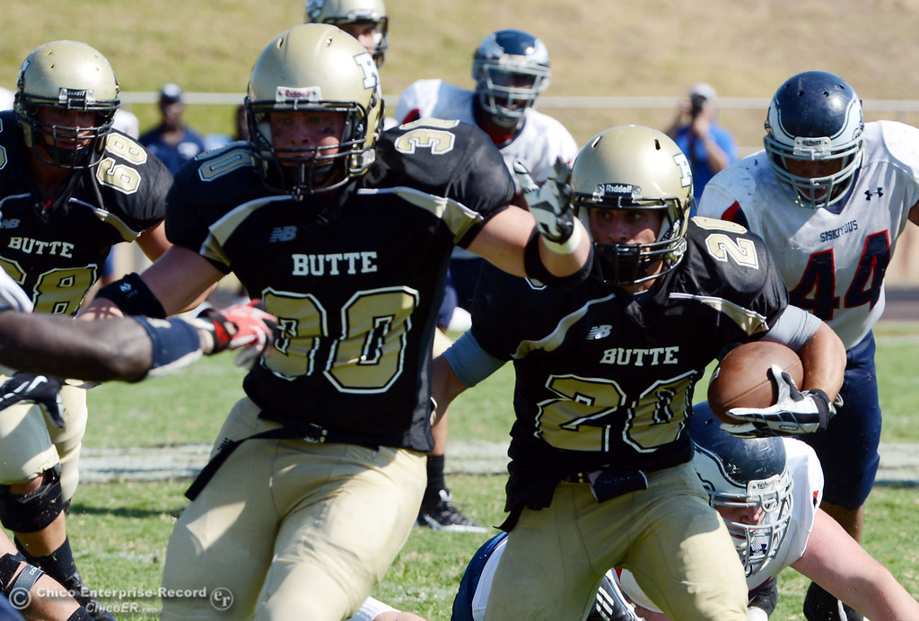 . Butte College\'s #30 Eric DeLucchi (left) blocks for #20 Armand Bokitch (right) against College of the Siskiyous in the third quarter of their football game at Butte\'s Cowan Stadium on Saturday, September 14, 2013, in Oroville, Calif. (Jason Halley/Chico Enterprise-Record)