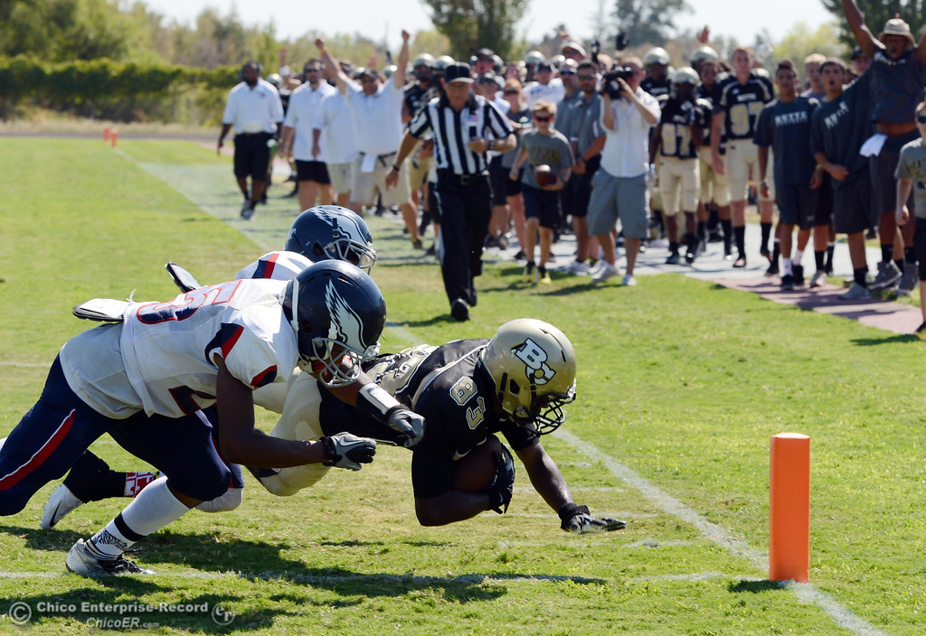 . Butte College\'s #83 Terez Cowan (right) is tackled in into the end zone against College of the Siskiyous\' ##25 Malachi Knox and #5 Darian Dyles (left) in the second quarter of their football game at Butte\'s Cowan Stadium on Saturday, September 14, 2013, in Oroville, Calif. The touchdown was nullified.  (Jason Halley/Chico Enterprise-Record)