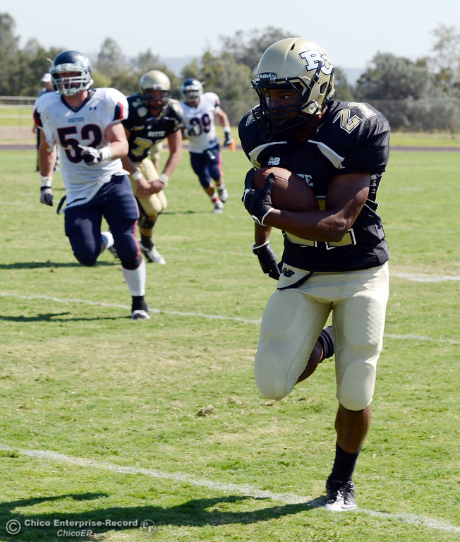 . Butte College\'s #21 Marvel Harris (right) rushes against College of the Siskiyous in the second quarter of their football game at Butte\'s Cowan Stadium on Saturday, September 14, 2013, in Oroville, Calif. (Jason Halley/Chico Enterprise-Record)