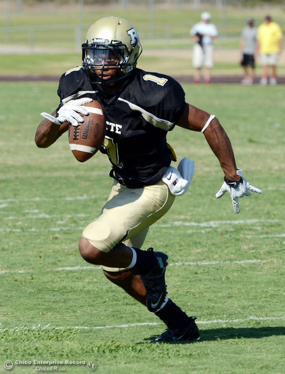 . Butte College\'s #1 Wes McCoy runs for a touchdown against College of the Siskiyous in the fourth quarter of their football game at Butte\'s Cowan Stadium on Saturday, September 14, 2013, in Oroville, Calif. (Jason Halley/Chico Enterprise-Record)