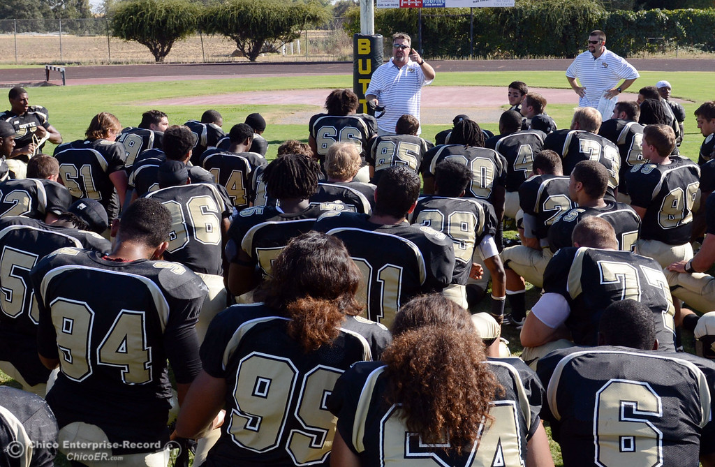 . Butte College head coach Jeff Jordan (center) talks to the team at the end of their football game against College of the Siskiyous at Butte\'s Cowan Stadium on Saturday, September 14, 2013, in Oroville, Calif. (Jason Halley/Chico Enterprise-Record)