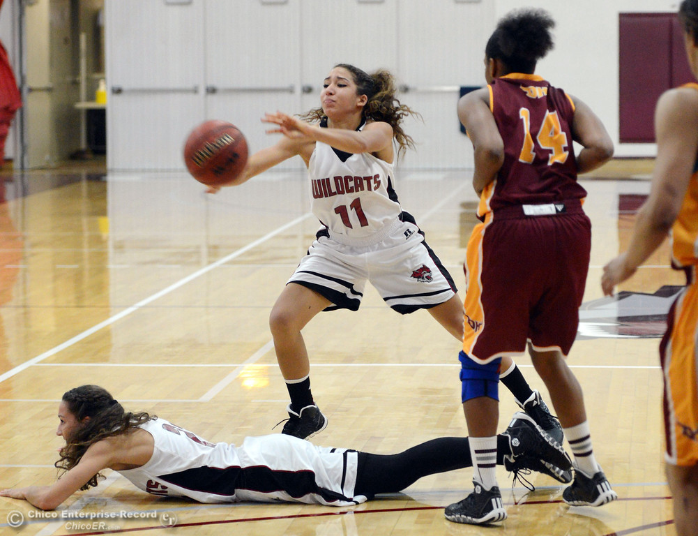 . Chico State\'s #21 Courtney Hamilton (bottom) picked up a loose ball as #11 Hannah Womack (center) passes against Cal State Dominguez Hills\' #14 Talia Rayford (right) in the second half of their women\'s basketball game at CSUC Acker Gym Friday, January 10, 2014 in Chico, Calif.  (Jason Halley/Chico Enterprise-Record)