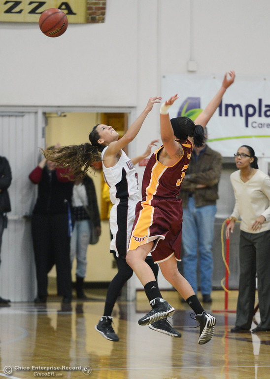 . Chico State\'s #21 Courtney Hamilton (left) blocks against Cal State Dominguez Hills\'s #3 Tayler Champion (right) in the second half of their women\'s basketball game at CSUC Acker Gym Friday, January 10, 2014 in Chico, Calif.  (Jason Halley/Chico Enterprise-Record)