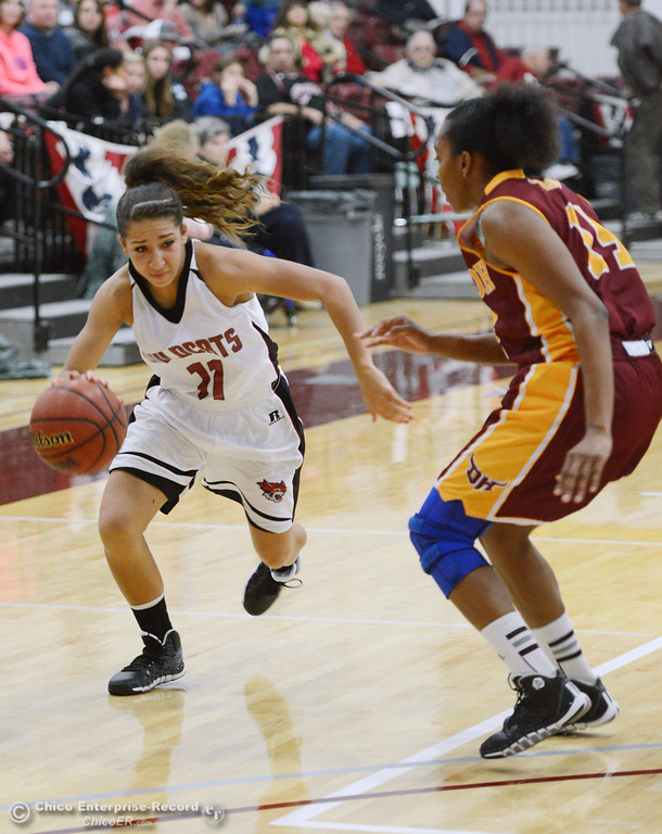 . Chico State\'s #11 Hannah Womack (left) dribbles against Cal State Dominguez Hills\' #14 Talia Rayford (right) in the second half of their women\'s basketball game at CSUC Acker Gym Friday, January 10, 2014 in Chico, Calif.  (Jason Halley/Chico Enterprise-Record)
