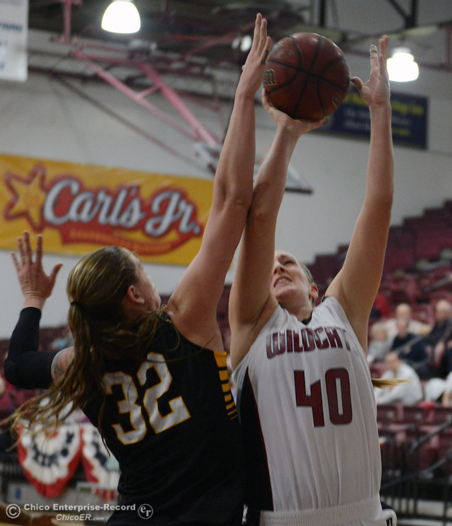 . Chico State\'s #40 Analise Riezebos (right) goes up for a shot against Cal State L.A.\'s #32 Destinee La Fountain (left) in the first half of their women\'s basketball game at CSUC Acker Gym Saturday, January 11, 2014 in Chico, Calif.  (Jason Halley/Chico Enterprise-Record)