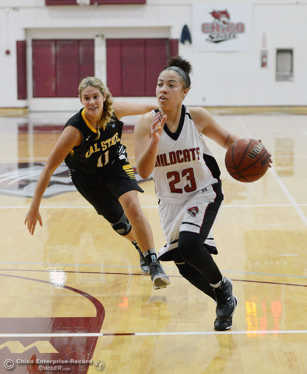. Chico State\'s #23 Jazmine Miller (right) dribbles against Cal State L.A.\'s # 11 Bre Parsons (left) in the first half of their women\'s basketball game at CSUC Acker Gym Saturday, January 11, 2014 in Chico, Calif.  (Jason Halley/Chico Enterprise-Record)