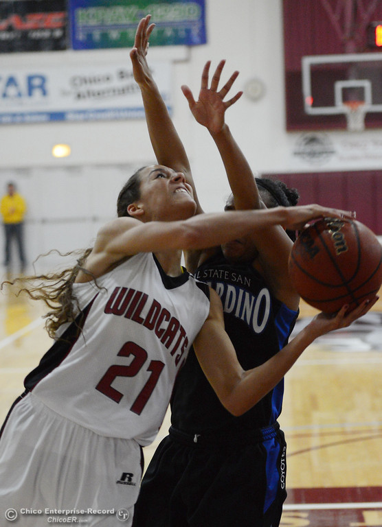 . Chico State\'s #21 Courtney Hamilton (left) goes up for a shot against Cal State San Bernardino\'s #4 Alexis Mack (right) in the second half of their women\'s basketball game at CSUC Acker Gym Saturday, February 8, 2014 in Chico, Calif.  (Jason Halley/Chico Enterprise-Record)