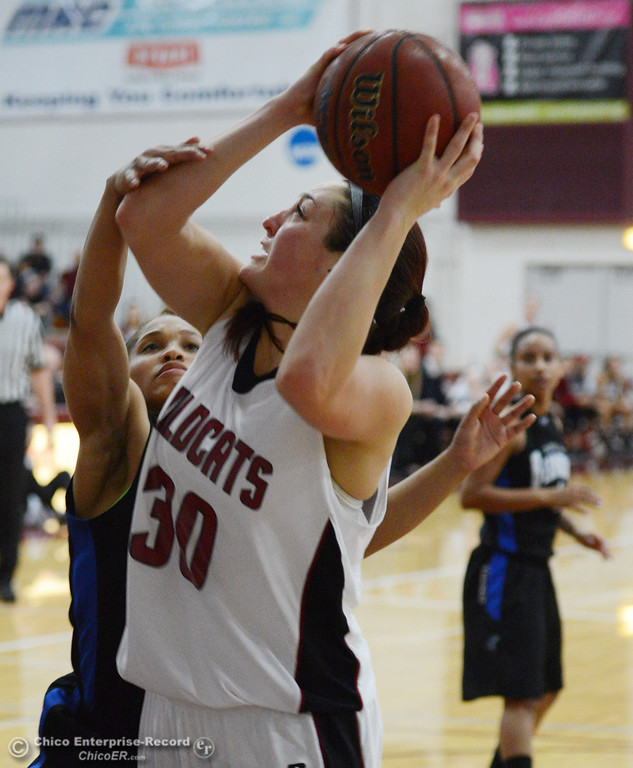 . Chico State\'s #30 McKenzie Dalthorp (right) takes a shot against Cal State San Bernardino in the first half of their women\'s basketball game at CSUC Acker Gym Saturday, February 8, 2014 in Chico, Calif.  (Jason Halley/Chico Enterprise-Record)