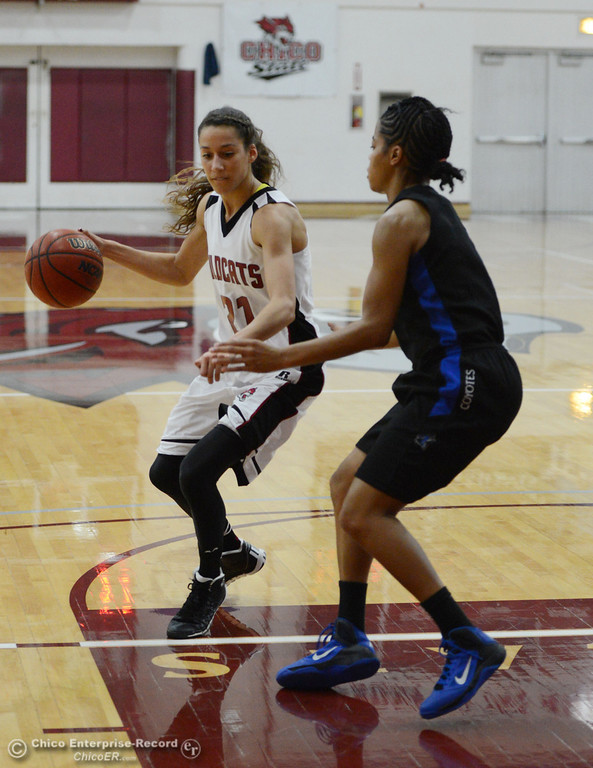 . Chico State\'s #21 Courtney Hamilton (left) dribbles against Cal State San Bernardino\'s #5 Tayllor Gipson (right) in the first half of their women\'s basketball game at CSUC Acker Gym Saturday, February 8, 2014 in Chico, Calif.  (Jason Halley/Chico Enterprise-Record)