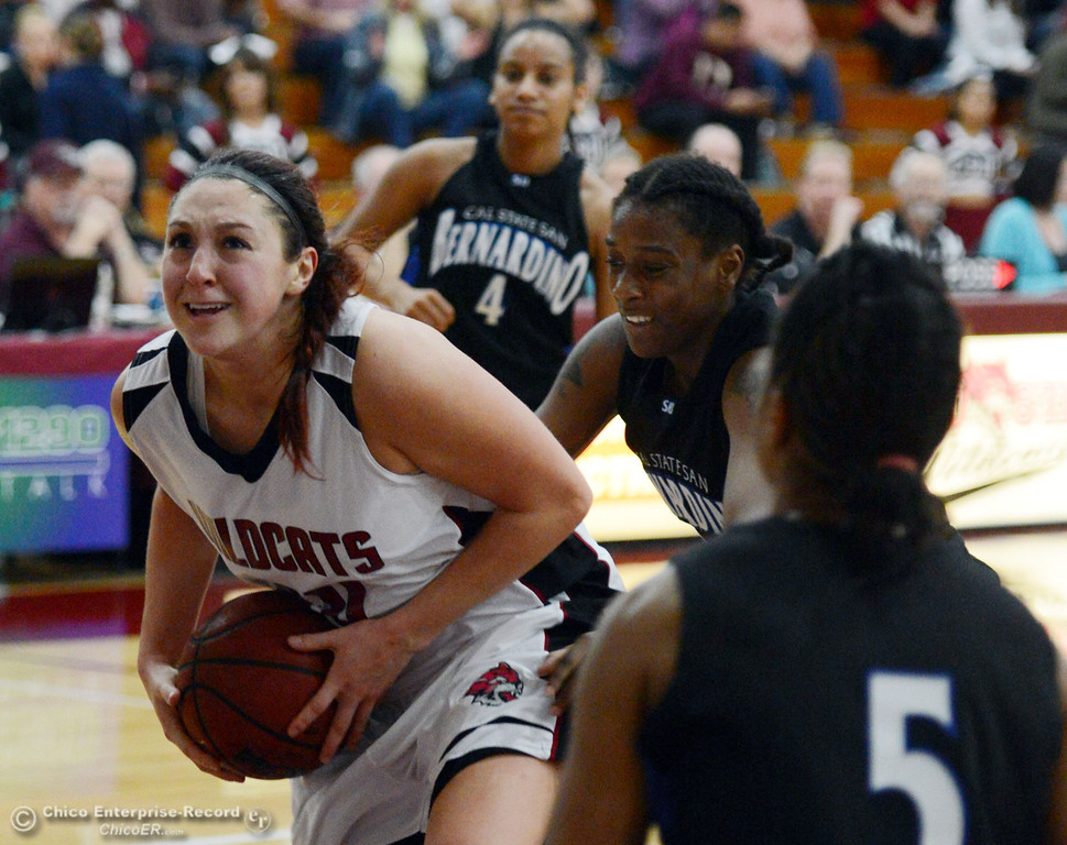 . Chico State\'s #30 McKenzie Dalthorp (left) dries to the basket against Cal State San Bernardino in the first half of their women\'s basketball game at CSUC Acker Gym Saturday, February 8, 2014 in Chico, Calif.  (Jason Halley/Chico Enterprise-Record)