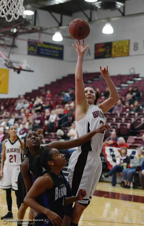 . Chico State\'s #30 McKenzie Dalthorp (right) takes a shot against Cal State San Bernardino\'s #32 Jazzmyn Davis (left) and #4 Alexcia Mack (bottom) in the first half of their women\'s basketball game at CSUC Acker Gym Saturday, February 8, 2014 in Chico, Calif.  (Jason Halley/Chico Enterprise-Record)