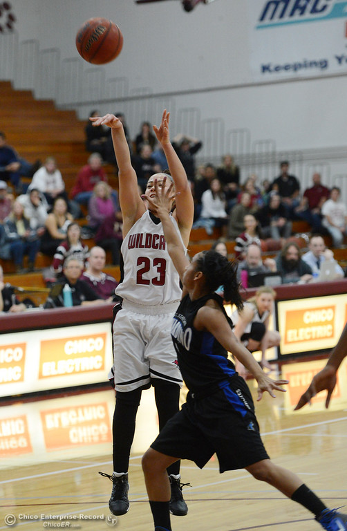 . Chico State\'s #23 Jazmine Miller takes a shot against Cal State San Bernardino\'s #4 Alexcia Mack (right) in the first half of their women\'s basketball game at CSUC Acker Gym Saturday, February 8, 2014 in Chico, Calif.  (Jason Halley/Chico Enterprise-Record)