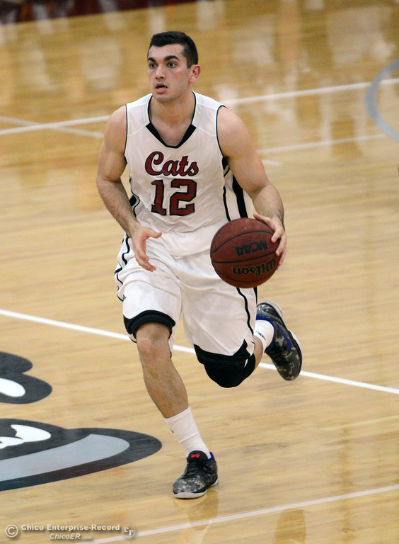 . Chico State\'s #12 Giordano Estrada dribbles against UC San Diego in the first half of their men\'s basketball game at CSUC Acker Gym Friday, February 7, 2014 in Chico, Calif.  (Jason Halley/Chico Enterprise-Record)
