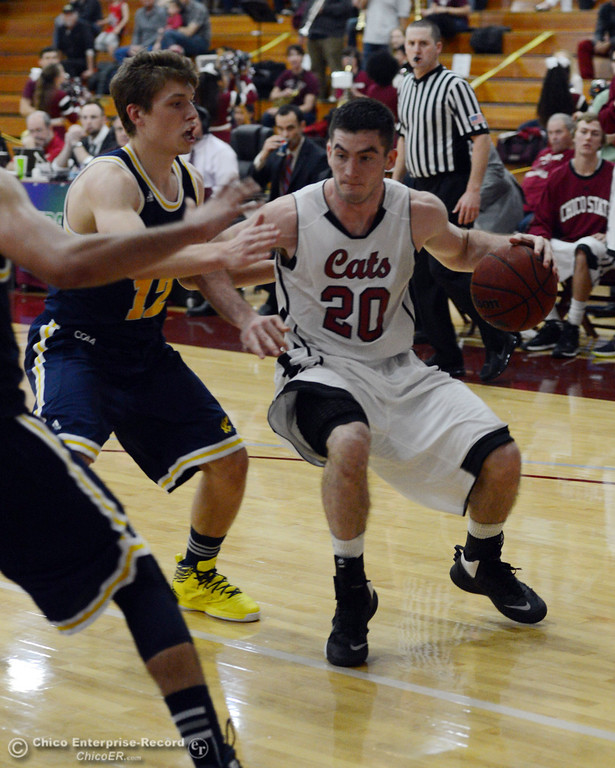 . Chico State\'s #20 Sean Park (right) dribbles against UC San Diego\'s #12 Adam Klie (left) in the second half of their men\'s basketball game at CSUC Acker Gym Friday, February 7, 2014 in Chico, Calif.  (Jason Halley/Chico Enterprise-Record)