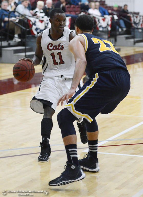 . Chico State\'s #11 Rashad Parker (left) dribbles against UC San Diego\'s #23 Hunter Walker (right) in the second half of their men\'s basketball game at CSUC Acker Gym Friday, February 7, 2014 in Chico, Calif.  (Jason Halley/Chico Enterprise-Record)