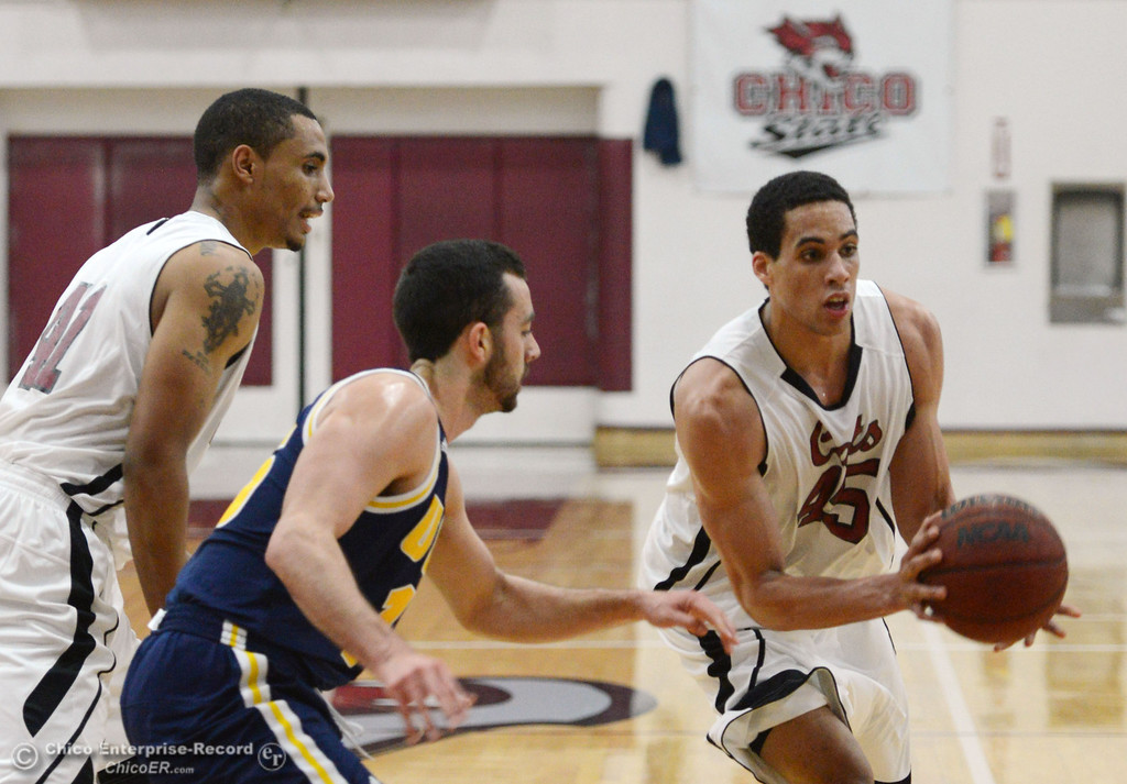 . Chico State\'s #41 Jordan Barton (left) blocks for #45 Jordan Semple (right) who dribbles against UC San Diego\'s #15 Aleks Lipovic (center) in the first half of their men\'s basketball game at CSUC Acker Gym Friday, February 7, 2014 in Chico, Calif.  (Jason Halley/Chico Enterprise-Record)
