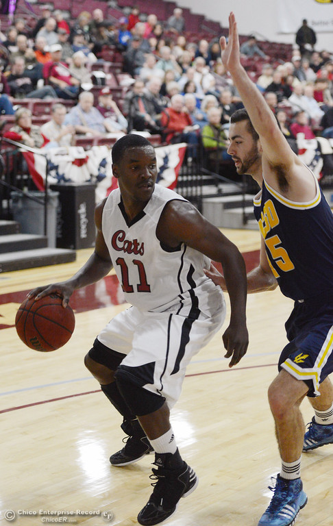 . Chico State\'s #11 Rashad Parker (left) dribbles against UC San Diego\'s #15 Aleks Lipovic (right) in the second half of their men\'s basketball game at CSUC Acker Gym Friday, February 7, 2014 in Chico, Calif.  (Jason Halley/Chico Enterprise-Record)
