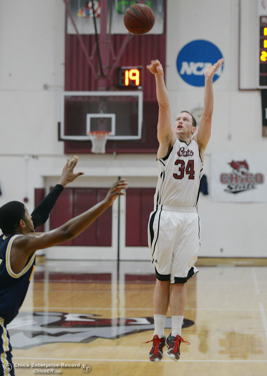 . Chico State\'s #34 Drew Kitchens takes a shot against UC San Diego in the first half of their men\'s basketball game at CSUC Acker Gym Friday, February 7, 2014 in Chico, Calif.  (Jason Halley/Chico Enterprise-Record)