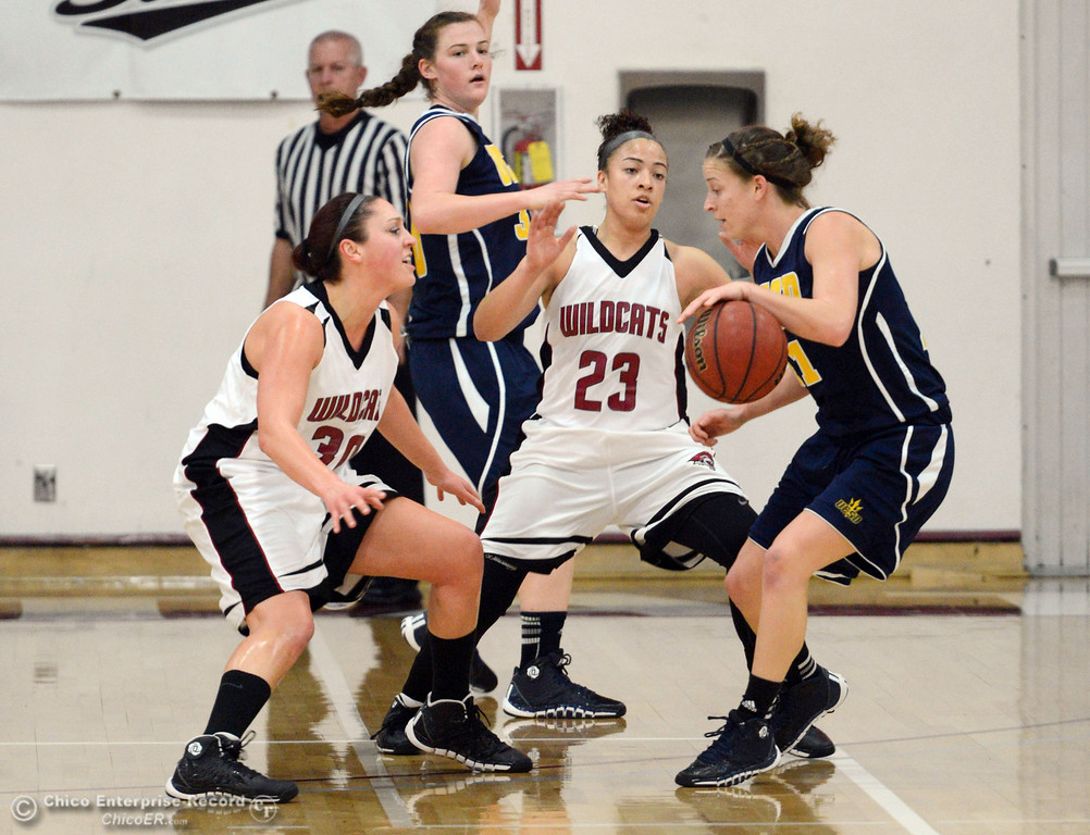 . Chico State\'s #30 McKenzie Dalthorp (left) and #23 Jazmine Miller (center) defend against UC San Diego\'s #21 Megan Perry (right) in the first half of their women\'s basketball game at CSUC Acker Gym Friday, February 7, 2014 in Chico, Calif.  (Jason Halley/Chico Enterprise-Record)