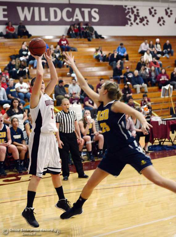 . Chico State\'s #30 McKenzie Dalthorp (left) takes a shot against UC San Diego\'s #25 Taylor Hirz (right) in the first half of their women\'s basketball game at CSUC Acker Gym Friday, February 7, 2014 in Chico, Calif.  (Jason Halley/Chico Enterprise-Record)