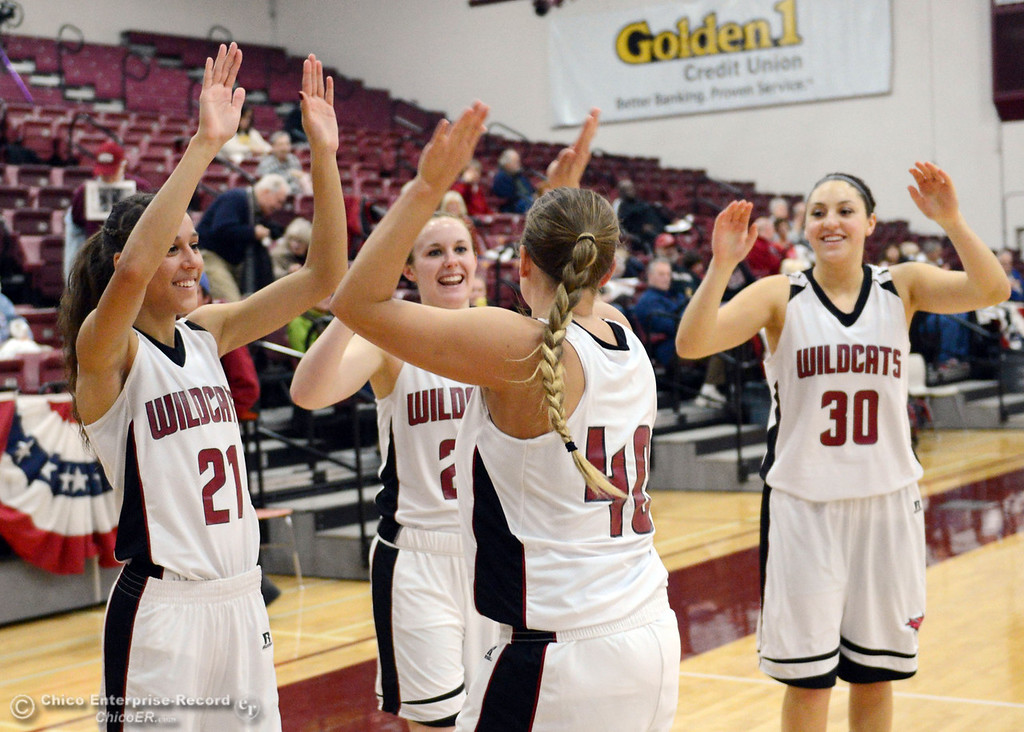 . Chico State\'s #40 Analise Riezebos (center) high fives #21 Courtney Hamilton, #20 Annie Ward, and #30 McKenzie Dalthorp (right) as they ready against UC San Diego in the first half of their women\'s basketball game at CSUC Acker Gym Friday, February 7, 2014 in Chico, Calif.  (Jason Halley/Chico Enterprise-Record)