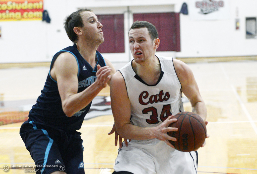 . Chico State\'s #34 Drew Kitchens (right) dribbles against Sonoma State\'s #3 Jason Walter (left) in the first half of their men\'s basketball game at CSUC Acker Gym Friday January 31, 2014 in Chico, Calif. (Jason Halley/Chico Enterprise-Record)