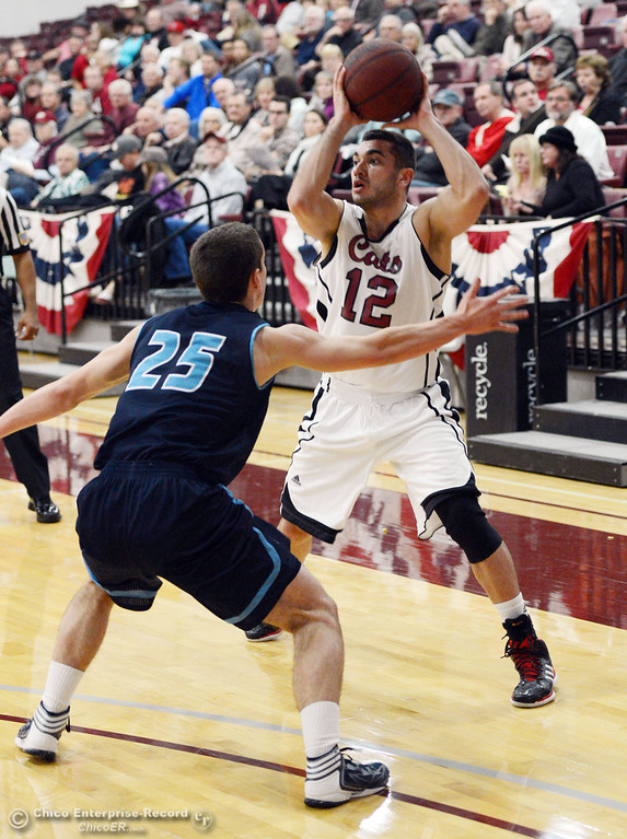 . Chico State\'s #12 Giordano Estrada (right) looks to pass against Sonoma State\'s #25 Chris Magalotti (left) in the first half of their men\'s basketball game at CSUC Acker Gym Friday January 31, 2014 in Chico, Calif. (Jason Halley/Chico Enterprise-Record)