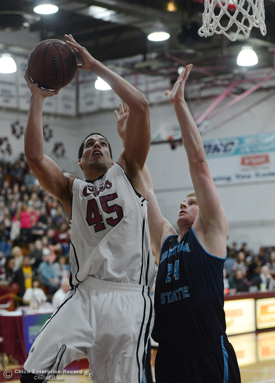 . Chico State\'s #45 Jordan Semple (left) goes up for a shot against Sonoma State\'s #24 Mike Harris (right) in the first half of their men\'s basketball game at CSUC Acker Gym Friday January 31, 2014 in Chico, Calif. (Jason Halley/Chico Enterprise-Record)