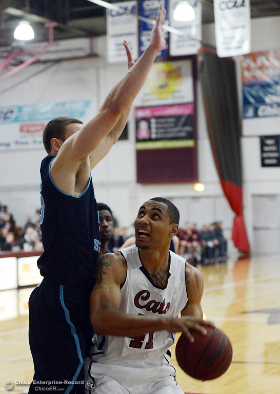 . Chico State\'s #41 Jordan Barton (right) goes up for a shot against Sonoma State\'s #35 Justin Herold (left) in the first half of their men\'s basketball game at CSUC Acker Gym Friday January 31, 2014 in Chico, Calif. (Jason Halley/Chico Enterprise-Record)