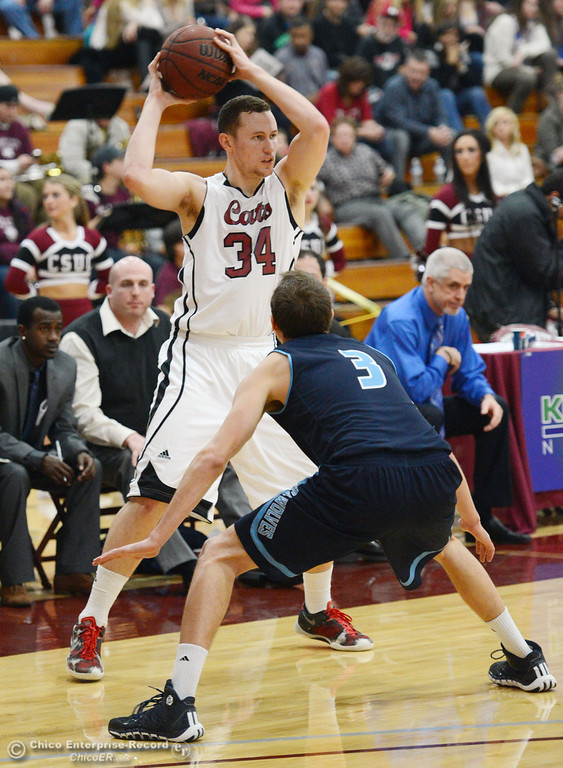 . Chico State\'s #34 Drew Kitchens (left) looks to pass against Sonoma State\'s #3 Jason Walter (right) in the first half of their men\'s basketball game at CSUC Acker Gym Friday January 31, 2014 in Chico, Calif. (Jason Halley/Chico Enterprise-Record)