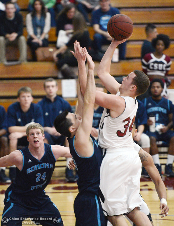 . Chico State\'s #34 Drew Kitchens (right) goes up for a shot against Sonoma State\'s #33 Sterling Arterberry (left) in the first half of their men\'s basketball game at CSUC Acker Gym Friday January 31, 2014 in Chico, Calif. (Jason Halley/Chico Enterprise-Record)