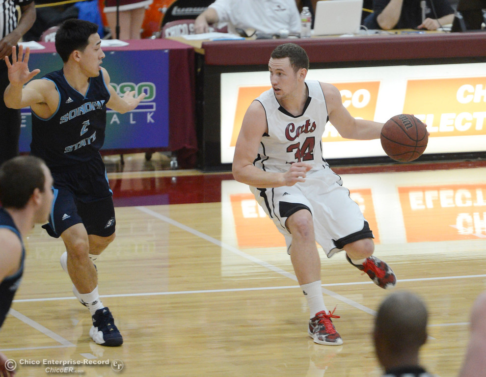 . Chico State\'s #34 Drew Kitchens (right) dribbles against Sonoma States\' #2 Zen Maki (left) in the first half of their men\'s basketball game at CSUC Acker Gym Friday January 31, 2014 in Chico, Calif. (Jason Halley/Chico Enterprise-Record)
