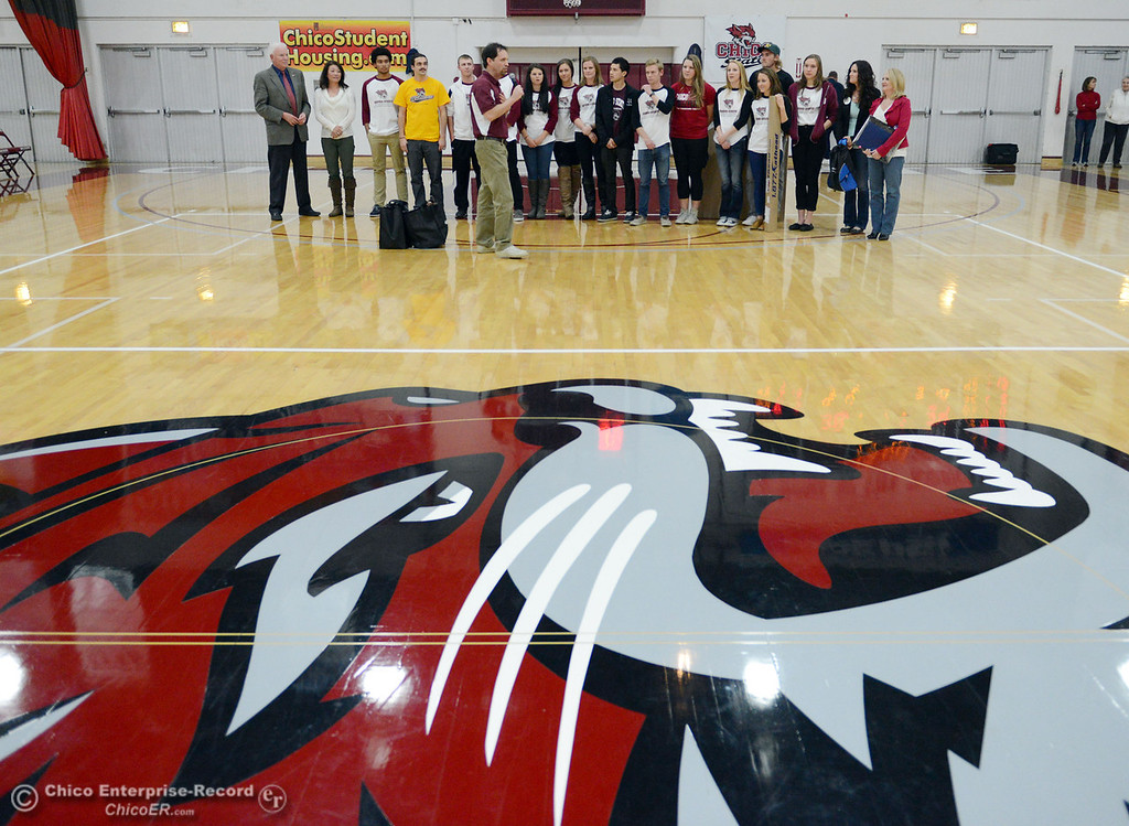 . Chico State SAAC presents $5,000 check and signed Aaron Rodgers jersey to Marcus Tice as part of the Make a Wish event at halftime of men\'s basketball game against Sonoma State at CSUC Acker Gym Friday January 31, 2014 in Chico, Calif. (Jason Halley/Chico Enterprise-Record)