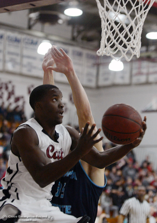 . Chico State\'s #11 Rashad Parker (front) goes up for a shot against Sonoma State\'s #35 Justin Herold (back) in the first half of their men\'s basketball game at CSUC Acker Gym Friday January 31, 2014 in Chico, Calif. (Jason Halley/Chico Enterprise-Record)